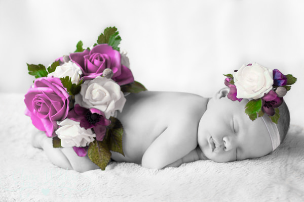 Newborn photograph in black and white with a beautiful splash of colour
