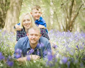family in bluebells, photoshoot in bluebells, horsham bluebells, barns green bluebells, boy in bluebells